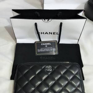Chanel zip around wallet lambskin. Gently used.